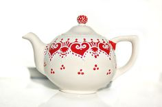 Red and white teapot detailed with white accent. $64.98, via Etsy.