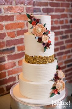 simple 4 tiered white wedding cake, smooth finish, pistachios, adorned peach & poppy flowers. The NotWedding Blog