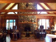 Full masonry fieldstone fireplace soars 24' inside this Tomahawk Log Home at 8219 Cth X, Three Lakes, WI 54562