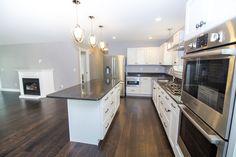 www.CCHFI.com Chase Custom Homes & Finance. Maine New Home Construction. Buxton, ME.  Modern Kitchen. Dark Hardwood Floors. Granite