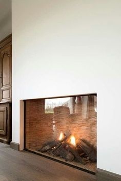 A modern fireplace instantly become a breathtaking focal point for any room, but with new advances in energy efficiency. - A modern fireplace instantly become a breathtaking focal point for any room, but with new advances in energy efficiency. Fireplace Built Ins, Home Fireplace, Fireplace Surrounds, Fireplace Design, Modern Fireplaces, Fireplace Outdoor, Fireplace Ideas, Corner Fireplaces, Tiled Fireplace