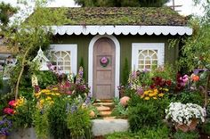 Dream Cottage.: Charming cottage created by Secret Garden Landscaping.