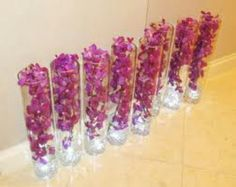 Glass cylinders w/ orchids
