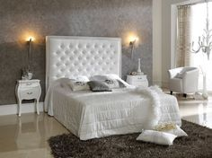 Luxury white tufted headboards in a bedroom design