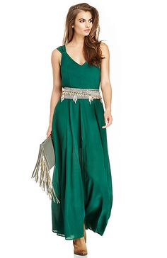 an emerald colored maxi dress and wear it with a variety of mixed metal belts.