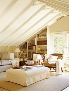 one of my favourite rooms of all time! Beautiful neutrals, ottoman, built in bookshelves, attic room, Love it!