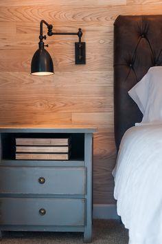 Refined rustic master bedroom. Metal sconces.