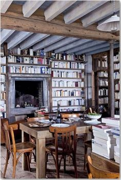 LOVE open dining areas surrounded by shelves of books—makes the table and area much more multi-purpose and encourages activities