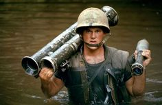 Larry Burrows. South of the DMZ, Vietnam, 1966 Marine gunner John Wilson, shouldering a rocket launcher, was part of a Marines reconnaissance force. He was killed in action twelve days later. (LIFE)