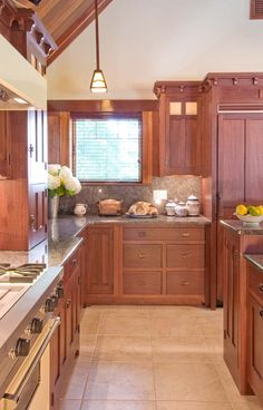 Arts & Crafts Gallery - Crown Point Cabinetry. I don't care much for the layout of this kitchen, but the cabinetry is stunning.