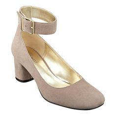 """As seen in the Nov 3rd issue of the New York Post.....Round toe pump with adjustable ankle strap on a 2"""" heel. ---Just ordered these. Hope I love them."""