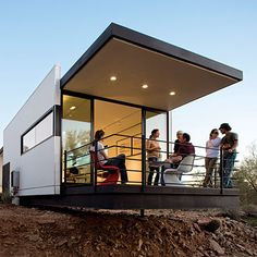 Frank Lloyd Wright-inspired prefab house  - The optimism and vision of Taliesin students are visible everywhere in this smart prefab located in Scottsdale, AZ. The result   of a design/build class.  It's a dynamic, livable house that honors Frank Lloyd Wright's legacy while tackling important design issues of today, from innovative prefabrication to sustainable systems like solar panels and rainwater and gray-water collection.