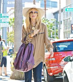"""Rachel Zoe- """"Here, the wider brim balances out the flare of her denim. It's all about proportion."""""""