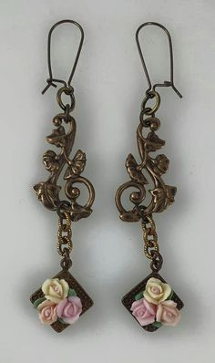used B'Sue filigree piece cut into 4th's, added some chain and B'Sue small ceramic flowers