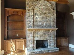stone fireplace with built in shelves on the sides!