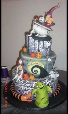 This is a birthday cake but, I kinda want my Wedding to be themed in The Nightmare Before Christmas! :D instead of the traditional Bride and Groom I want Jack and Sally as my cake toppers!! ^_^