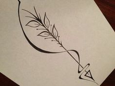 this may be my next tattoo... looks like a cross between an arrow and a quill! love it!