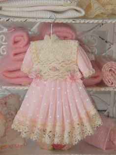 Dollhouse pink girl dress on hang. 1:12 dollhouse miniature dress on hang.
