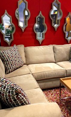 Decorate the walls of your home with shapely mirrors. #sofa #living_room | Houston TX | Gallery Furniture |