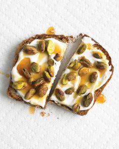Whole-Grain Toast with Yogurt and Pistachios   Martha Stewart Living - Get into the Mediterranean spirit by slathering creamy Greek yogurt and honey on whole–grain toast. Pistachios add the necessary crunch factor.
