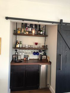 A friend's home bar 1/3. This is the concept that I think would be good for dave's bar. The shelving is a mixture of liquor and glassware. The counter has some of the barware tools for making drinks. Below has an ice maker, a built in fridge and drawers. I would avoid dedicated wine fridges. white can be kept in regular fridge. reds can go in a wine rack section of the bar. (or if there's room in the bottom area add one down there.)