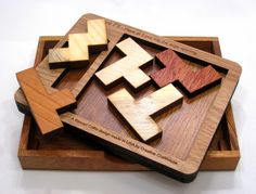 """This week saw the arrival of three """"coffins"""" to my home! Three Coffin-designed packing puzzles to be accurate. They are:-   1. The Cruiser ..."""
