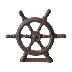 Classic, creative, and nautical, this rustic cast iron captain's wheel doorstop is crafted to stand strong against a door, providing an attractive design and function without any clutter or tripping ha...  Find the Captain's Wheel Doorstop, as seen in the New England Chic Collection at http://dotandbo.com/collections/new-england-chic?utm_source=pinterest&utm_medium=organic&db_sku=90187