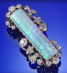 OPAL AND DIAMOND BROOCH, CIRCA 1890, SET WITH A BATON-SHAPED OPAL