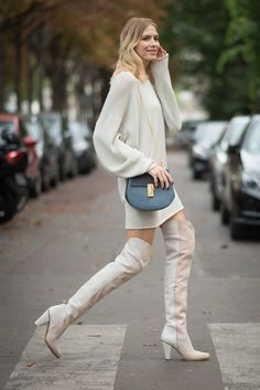 Elena Perminova in thigh-high boots and a sweater dress