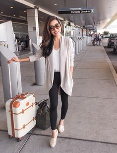 Comfortable + casual airport travel outfit // black leggings + cozy cardigan + flat loafer shoes (click the image to shop the look!)