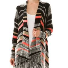 NWT Aztec Cardigan Sweater Gorgeous striped cardigan sweater. Coral, black, white, and tan colors. Fringed at bottom. High low look. 55% cotton 45% acrylic. I kept one of these for myself.. I love it!! Price is firm, unless bundled. No trades. Sizes are labeled S/M and M/L. Sweaters Cardigans
