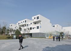 Image 7 of 22 from gallery of The R&D and innovative port of Anting International Automobile City, Site D / Atelier Deshaus. Photograph by SU Shengliang Social Housing, Innovation, Automobile, Louvre, Street View, City, Gallery, Building, Travel