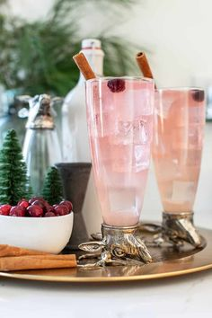 Tis the season for the best Christmas cocktails! From the best eggnog to the most beautiful cranberry thyme gin and tonic. We're sharing the absolute best cocktail recipes to make your holiday brighter! #ChristmasCocktails #Cocktails #HolidayDrinks #HolidayCocktail #CocktailRecipes Recipe With Cranberry Juice, Cranberry Vodka, Best Christmas Cocktails, Holiday Drinks, Best Gin And Tonic, Collins Recipe, Cocktails Made With Gin, Cocktail Desserts, Cocktail Recipes
