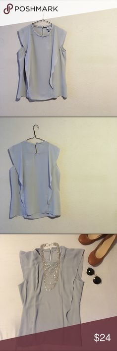 """Dusty Gray blue Blouse New without tags//beautiful lightweight blouse//gathered detailing around neck and a button closure at back of neck//sheer capped sleeves//perfect for professional or casual wear//it is a lovely dusty blue gray//measurements: armpit to armpit @ 18""""//total length @ 23"""" Worthington Tops Blouses"""