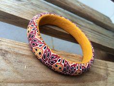 Polymer clay kaleidoscope pattern bangle by Dev'Art60.