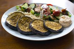 Za'atar Roasted Eggplant with Quinoa, Hummus, and Fattoush Salad  http://www.runnersworld.com/the-ravenous-runner/zaatar-roasted-eggplant-with-quinoa-hummus-and-fattoush-salad