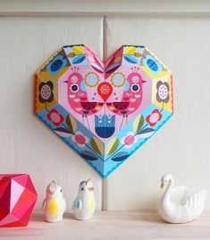 A folded paper heart makes a bright and cheery springtime decoration.