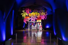 Bar Mitzvah Dramatic Entrance - Colorful Escort Table with Vibrant Colors & Exotic Flowers {Cristina Calvi Photography, Gala Event and Food Artistry NY} - mazelmoments.com