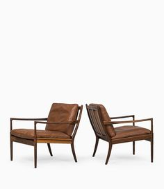 Ib Kofod-Larsen; Rosewood and Leather 'Samsö' Lounge Chairs for OPE, 1950s. Via Studio Schalling.
