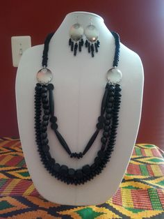 This long wood piece is very light to wear.  This goes well with all colors.  The dangling earrings just take it to another level.