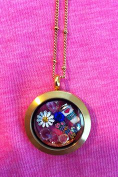 My older sisters she loves coffee & daisies.  Medium gold locket. Mothers Day Present!