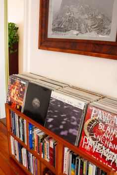 record storage - add a lip to any bookcase...easily accessible and displayed to show off artwork!