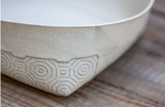 White stoneware salad bowl, made of white glazed ceramic with a delicate geometric Hexagon pattern. Bowl is folded from a ceramic surface by hand creating square corners. Great to serve your fresh picked fruits or a green salad. recommended for baking & serving in it a home made bread or