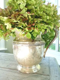 Pretty green hydrangea in a silver pitcher. This really is a simple, lovely flower arrangement.