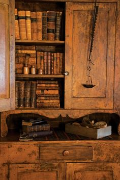 cool leather books and cupboard.......I LOVE the look of old leather books and nice wood. My whole house will look like this. :)