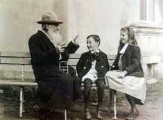 Leo Tolstoy telling a story to his grandchildren in 1909