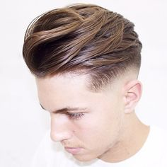 This messy slick style with razor fade is fresh.