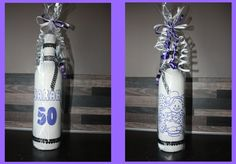 Geef een fles wijn cadeau bij een 50-jarige verjaardag. Handbeschilderd en gedecoreerd.
