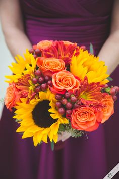 Brilliant fall bridesmaid bouquet with sunflowers, roses, and berries!