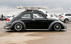 VW Beetle, slammed on BRM's, two-tone black & charcoal with roof rack and surf board. Perfect.